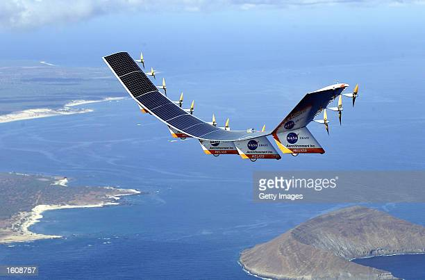 The solarelectric Helios Prototype flying wing is flies over the Hawaiian islands of Niihau and Lehua during the first solarpowered test flight July...