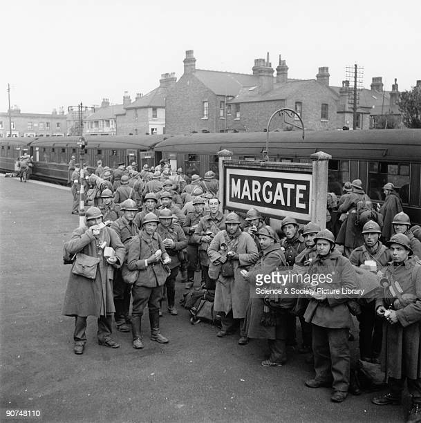 The soldiers had been evacuated from Dunkirk and were waiting to board a Londonbound train During the war many official railway photographers used...