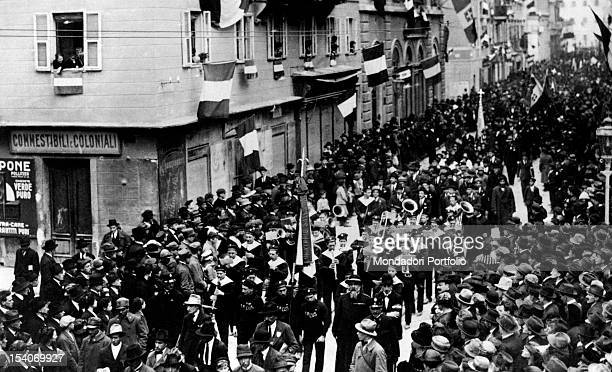 The soldiers of the Italian army playing and parading in the streets of the city to celebrate the signing of the armistice and the end of First World...