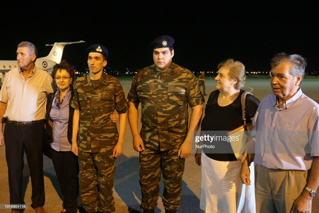 the soldiers with their family two greek soldiers have been