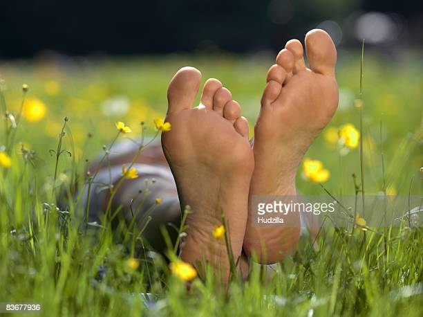 The soles of a person's bare feet, close up