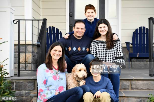 The Solomon's clockwise from lower left Regina Ted Brady Ella Luke 10 and their dog Cooper fell in love with the spec home immediately and would not...
