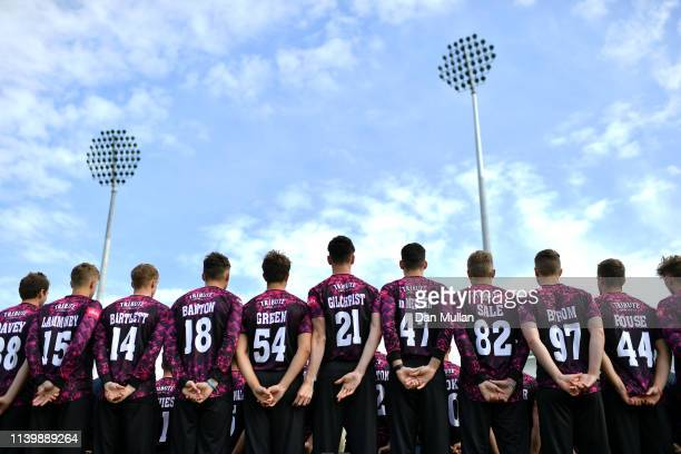 The Somerset players and coaching staff pose for a team photo in their Vitality Blast kit during the Somerset County Cricket Club photocall at The...