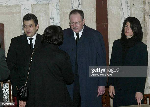The son and daughter of Egypt's late King Faruq Ahmed Fuad and Yasmine receive condolences with an unidentified relative during the funeral of their...
