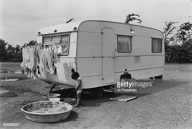 The son of a circus performer urinates outside his caravan at the 'Clyde BeattyCole Bros Circus' USA 1971