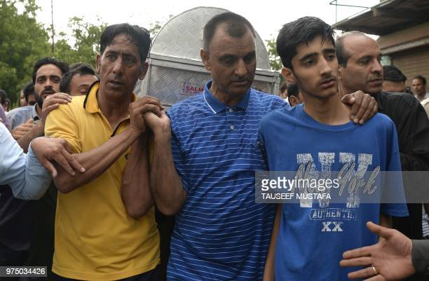 The son of a slain editorinchief of the Srinagarbased newspaper Rising Kashmir Shujaat Bukhari mourns during the funeral procession at Kreeri some 40...