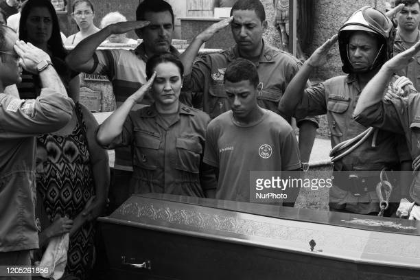 The son of Cabo Moraes and other firefighters during the firefighter Rogerio de Moraes Santos funeral at Cemiterio Saudade e Funeraria Municipal Vila...