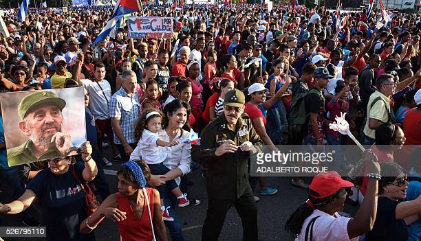 The son of Cuban President Raul Castro Alejandro Castro and his family participate in the May Day parade in Havana on May 1 2016 / AFP / ADALBERTO...