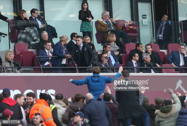 The son of David Sullivan speaks with a member of staff as fans protest below on the concourse during the Premier League match between West Ham...