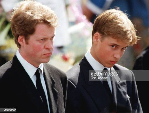 The son of Diana Prince William and her brother Earl Spencer wait in front of Westminster Abbey in London to attend the funeral ceremony of the...