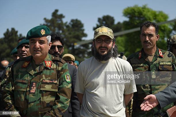 The son of former Pakistani prime minister Yousaf Raza Gilani Ali Haider Gilani looks on as he is escorted by Afghan Special Forces personnel from an...