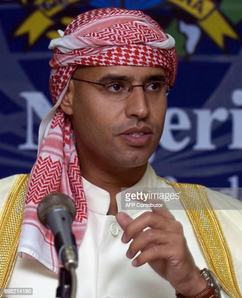The son of Libyan leader Moamer Kadhafi Sayef alIslam Kadhafi speaks during a press conference in Jakarta 10 November 2004 Libya began rebuilding its...