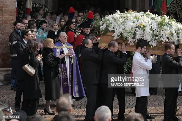 The son of Michele Ferrero Giovanni Ferrero and his mother Maria Franca Ferrero applaud the coffin of Michele Ferrero during the funeral on February...