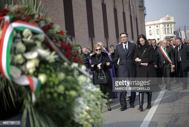 The son of Michele Ferrero Giovanni Ferrero and his wife Paola walk along with the widow Maria Franca Ferrero during the funeral on February 18 2015...
