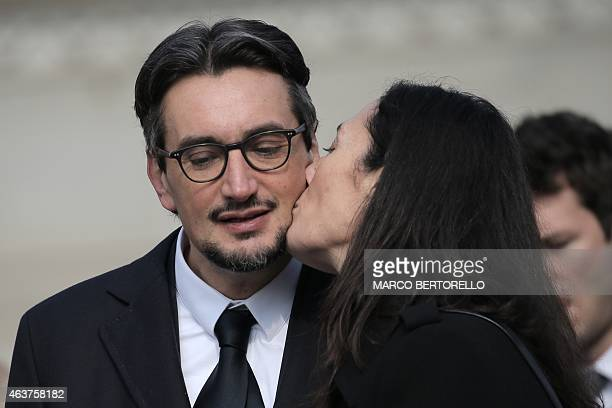 The son of Michele Ferrero Giovanni Ferrero receives a kiss from his wife Paola during the funeral of his father on February 18 2015 in Alba northern...