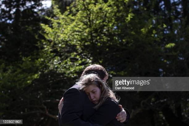 The son of the late Eric Stonestreet Daniel and daughter Victoria embrace after the service for their father at Ipswich Crematorium on May 5 2020 in...
