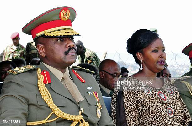 The son of Uganda's President Yoweri Museveni Major General Muhoozi Kainerugaba and his wife Charlotte Kutesa Kainerugaba attend a ceremony in which...