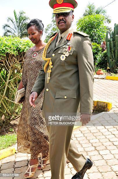 The son of Uganda's President Yoweri Museveni Major General Muhoozi Kainerugaba and his wife Charlotte Kutesa Kainerugaba arrive to attend a ceremony...