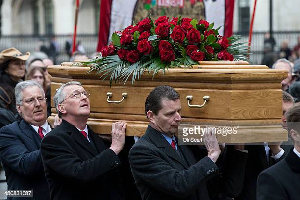 The sons and grandsons of Tony Benn including Stephen Benn and Hilary Benn carry his coffin into St Margaret's Church on March 27 2014 in London...