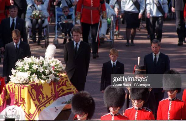 The sons of Diana Princess of Wales her brother and her former husband the Prince of Wales somberly walk behind her coffin as the funeral procession...