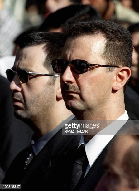 The sons of Syria's late President Hafez alAssad Maher and heir apparent Bashar march behind their father's coffin during his funeral in Damascus 13...