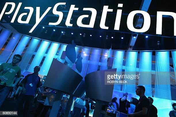 The Sony PlayStation exhibit draws visitors at the Electronic Entertainment Expo or E3 at the Los Angeles Convention Center in Los Angeles 12 May...
