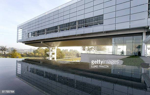 The soon-to-be opened William J. Clinton Presidential Library in Little Rock, Arkansas is reflected in a pool 17 November 2004. The grand opening of...