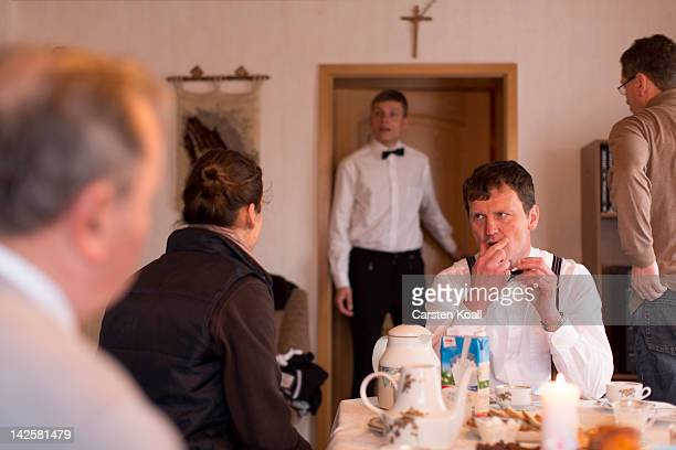 The sorbian Michael Kretschmer takes a breakfast before the beginning of the easter rider parade on horseback on April 08 2012 in Dubring near...