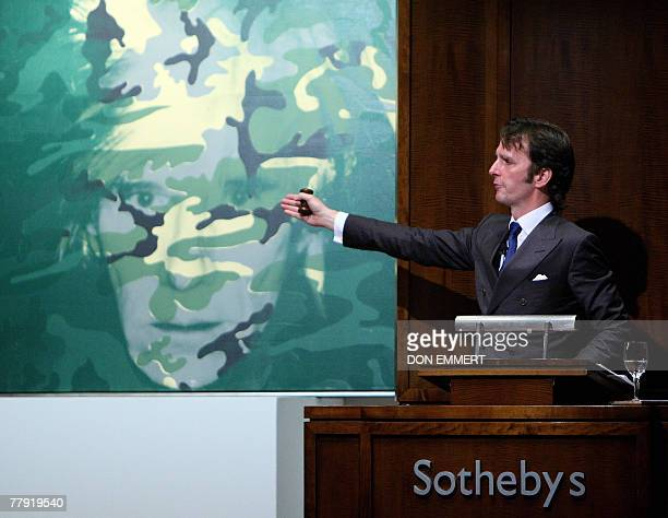 The Sotheby's auctioneer looks for bids on Andy Warhol's self portrait 14 November 2007 in New York The piece was sold during Sotheby's sale of...