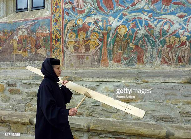 """The sound of """"toaca"""" is used to call the nuns to pray. This photo is taken at the church/monastery of Moldovita, in the Bukovina region of Romania...."""