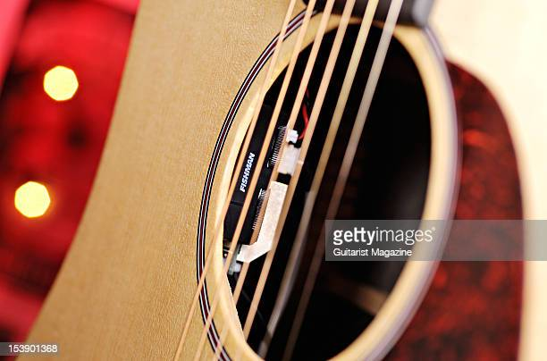 The soundhole and built in Fishman pickup of a Martin DX1KAE acoustic guitar during a studio shoot for Guitarist Magazine September 20 2010