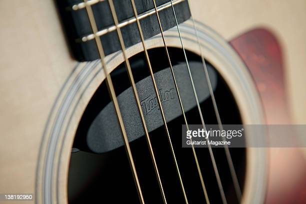 The soundhole and pickup of a Taylor GS Mini acoustic guitar During a studio shoot for Guitarist Magazine February 3 2011