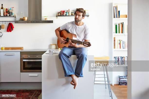 the soundtrack for the day - guitarra imagens e fotografias de stock