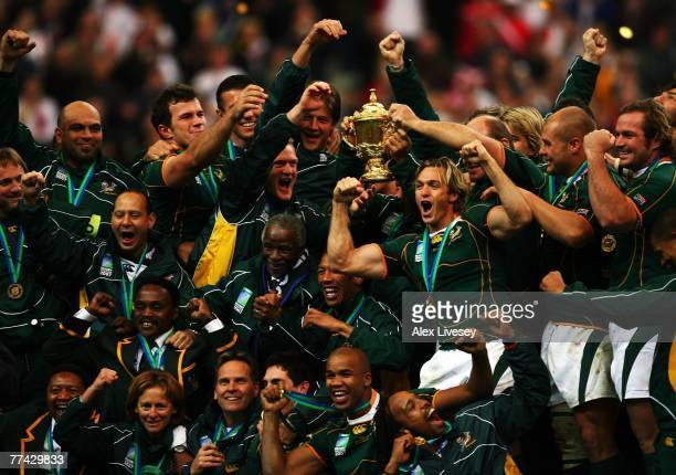 The South Africa players and staff celebrate with the trophy following their team's victory at the end of the 2007 Rugby World Cup Final between...