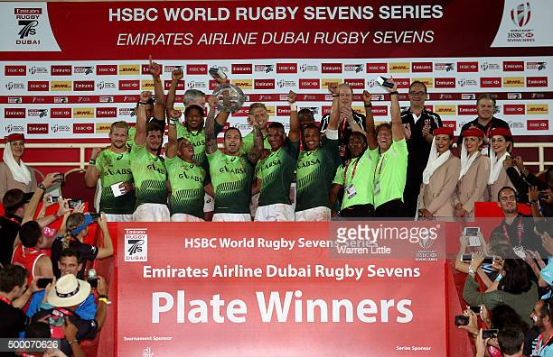 The South Africa team celebrate beating Australia in the Plate Final during the Emirates Dubai Rugby Sevens HSBC World Rugby Sevens Series at The...