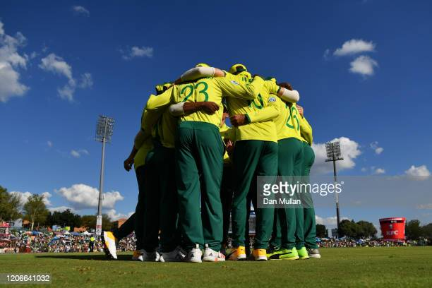 The South Africa team huddle for a team talk ahead of taking to the field to start the second innings during the Third T20 International match...
