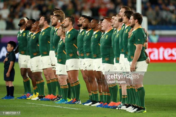 The South Africa team line up as they sing their national anthem prior to the Rugby World Cup 2019 SemiFinal match between Wales and South Africa at...