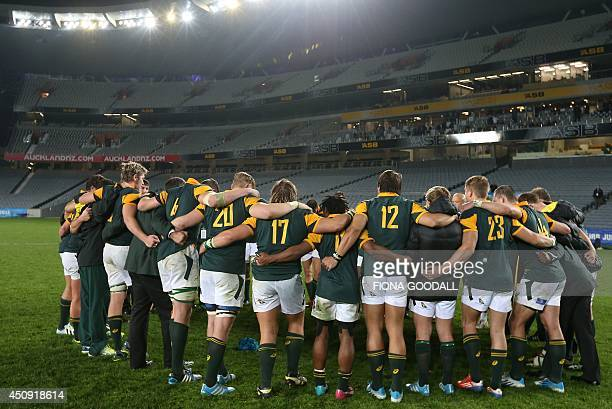 The South Africa team stand together after their loss to England during the U20 Junior World Championship rugby union final match between England and...