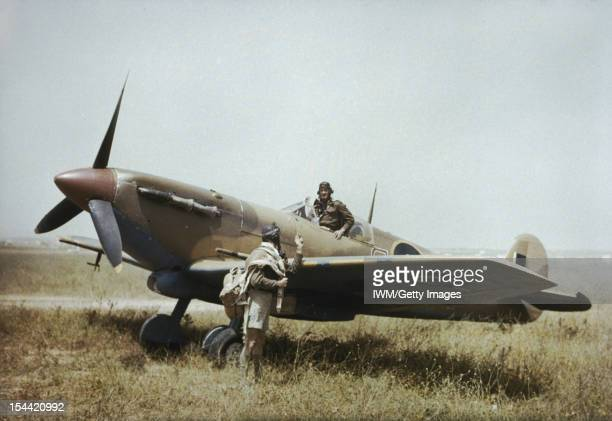 The South African Air Force In Tunisia April 1943 The Supermarine Spitfire pilot of ER622 No 40 Squadron South African Air Force confers with his 'No...