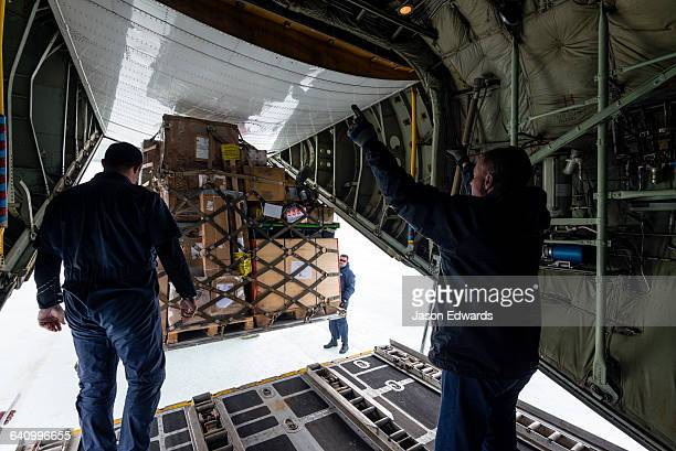 The South African crew of a US Air force Hercules unloading cargo to an Italian base in Antarctica.