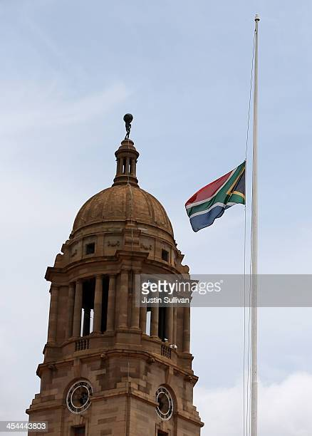 The South African flag flies at half mast in front of the Union Buildings on December 9 2013 in Pretoria South Africa Final preparations are being...