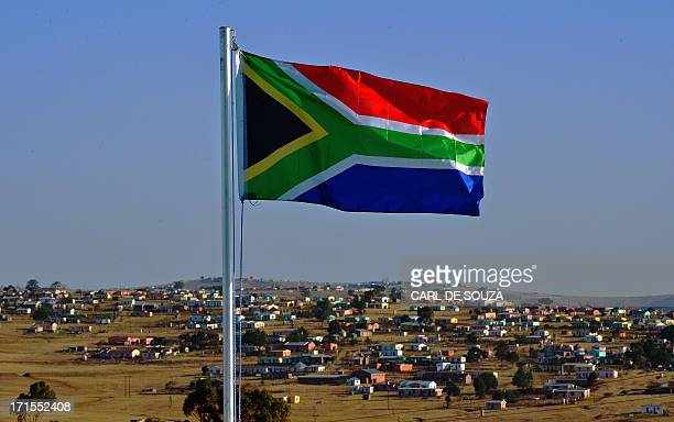 The South African flag flies near Qunu on June 26 2013 Qunu is the city where former South African President Nelson Mandela grew up Mandela remains...