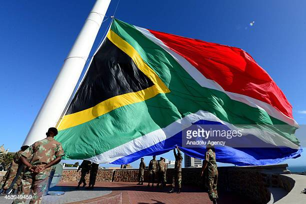 The South African flag lies at halfstaff in tribute to former South African President Nelson Mandela following the his death in Port Elizabeth South...