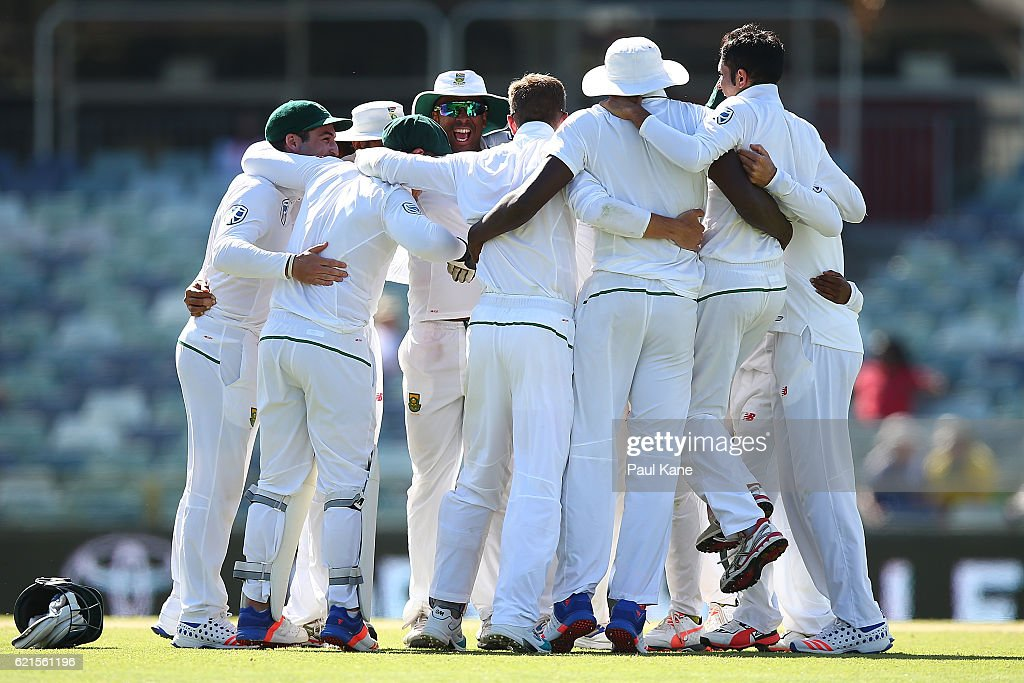 The South African players celebrate defeating Australia during day five of the First Test match between Australia and South Africa at the WACA on November 7, 2016 in Perth, Australia.