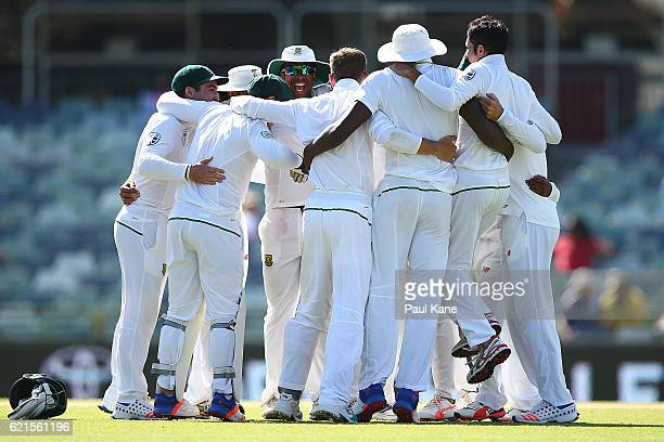 The South African players celebrate defeating Australia during day five of the First Test match between Australia and South Africa at the WACA on...