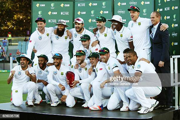 The South African squad celebrates with the trophy after winning the series at the end of day four of the Third Test match between Australia and...