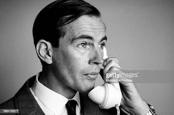 The South African surgeon Christiaan Barnard engrossed in conversation on the telephone Barnard is busy on a European tour to talk about his...