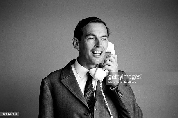 The South African surgeon Christiaan Barnard talks on the phone in his hotel room and laughs Lisbon February 1968