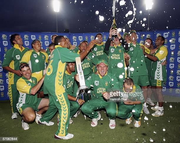 The South African team celebrate their series win with the trophy during the fifth One Day International between South Africa and Australia played at...