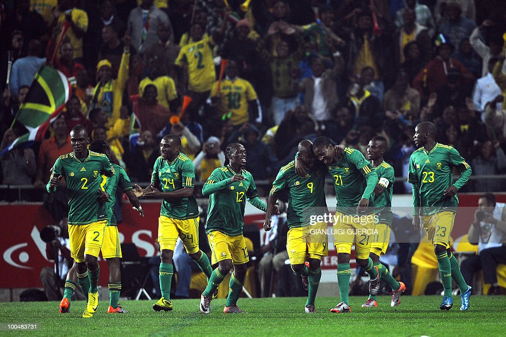 The South African team celebrates after scoring a goal against Bulgaria during their international friendly football match at the Orlando stadium in Soweto, Johannesburg. on May 24, 2010. The 2010 FIFA World Cup football championship is due to take place in South Africa from June 11 to July 11 of 2010.